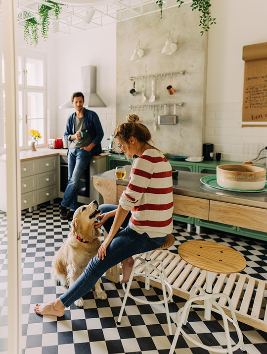 couple in the kitchen with their dog